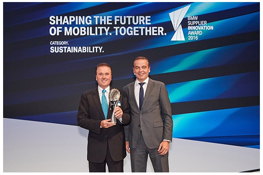 Tony Hankins, President of Huntsman Polyurethanes (left) Receives the BMW Supplier Innovation Award for Sustainability